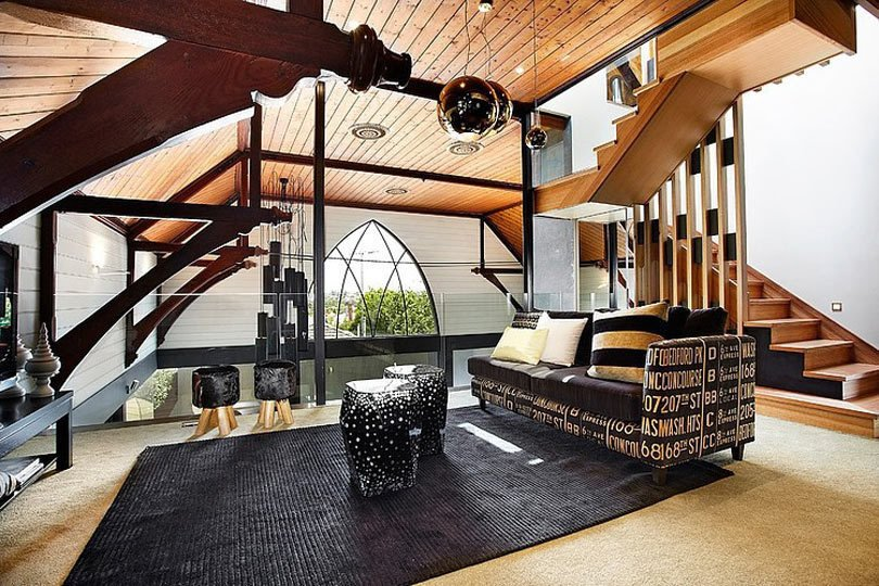 In Melbourne, Australia, architects converted an 1892 wood frame church into a single-family home and inserted a second-floor mezzanine that opens to the main level below. The architects selected wood stair treads and railings that echo the wood decking and trusses of the roof, but with a modern twist.