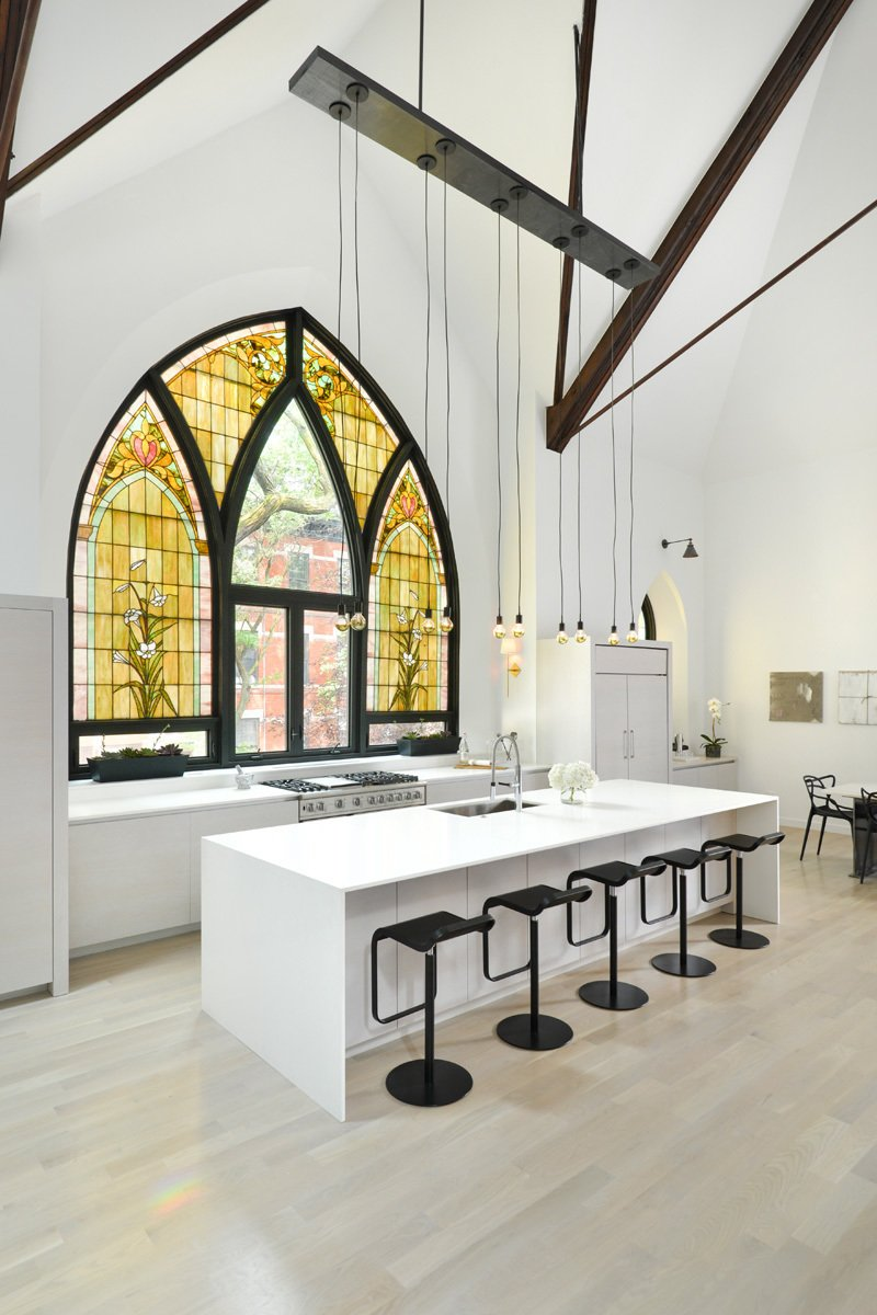 This church conversion in Chicago was transformed into a single-family home. Arched stained-glass windows were maintained, and some panels were swapped out for clear glass.