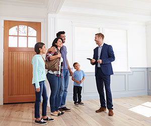 Family Touring a Home with a Real Estate Agent