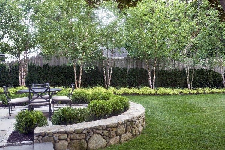 using Hardscaping, like stone or brick pavers, to create outdoor rooms