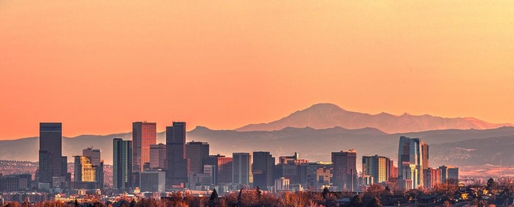 Denver skyline with orange sunset
