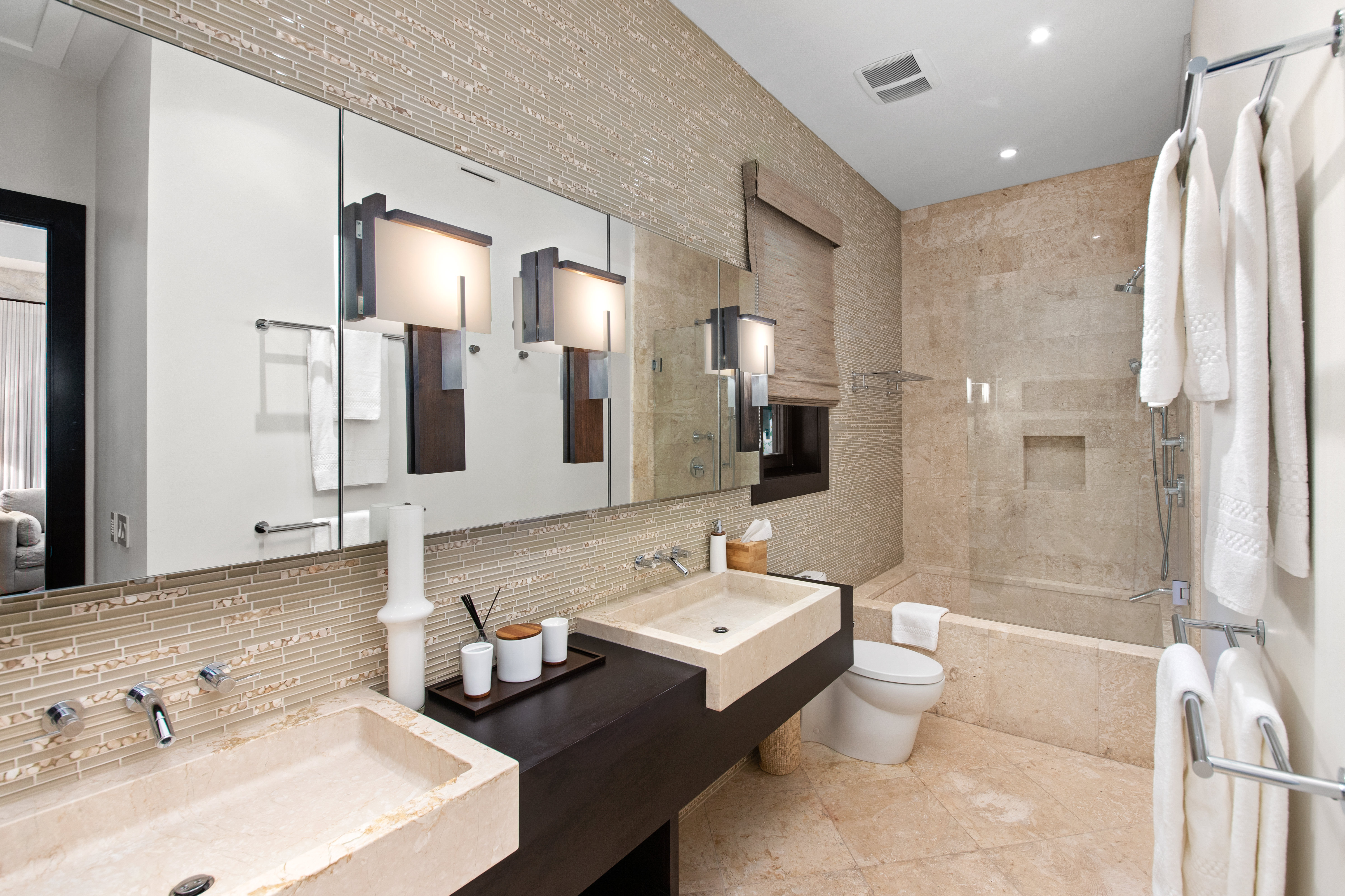 Large Bathroom with Dual Sinks, Shower, and Tub