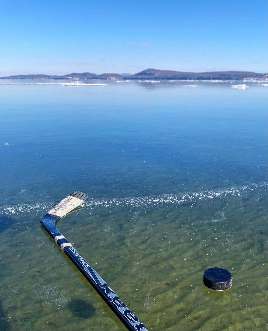 lake hockey on frozen lake near sandbar causeway