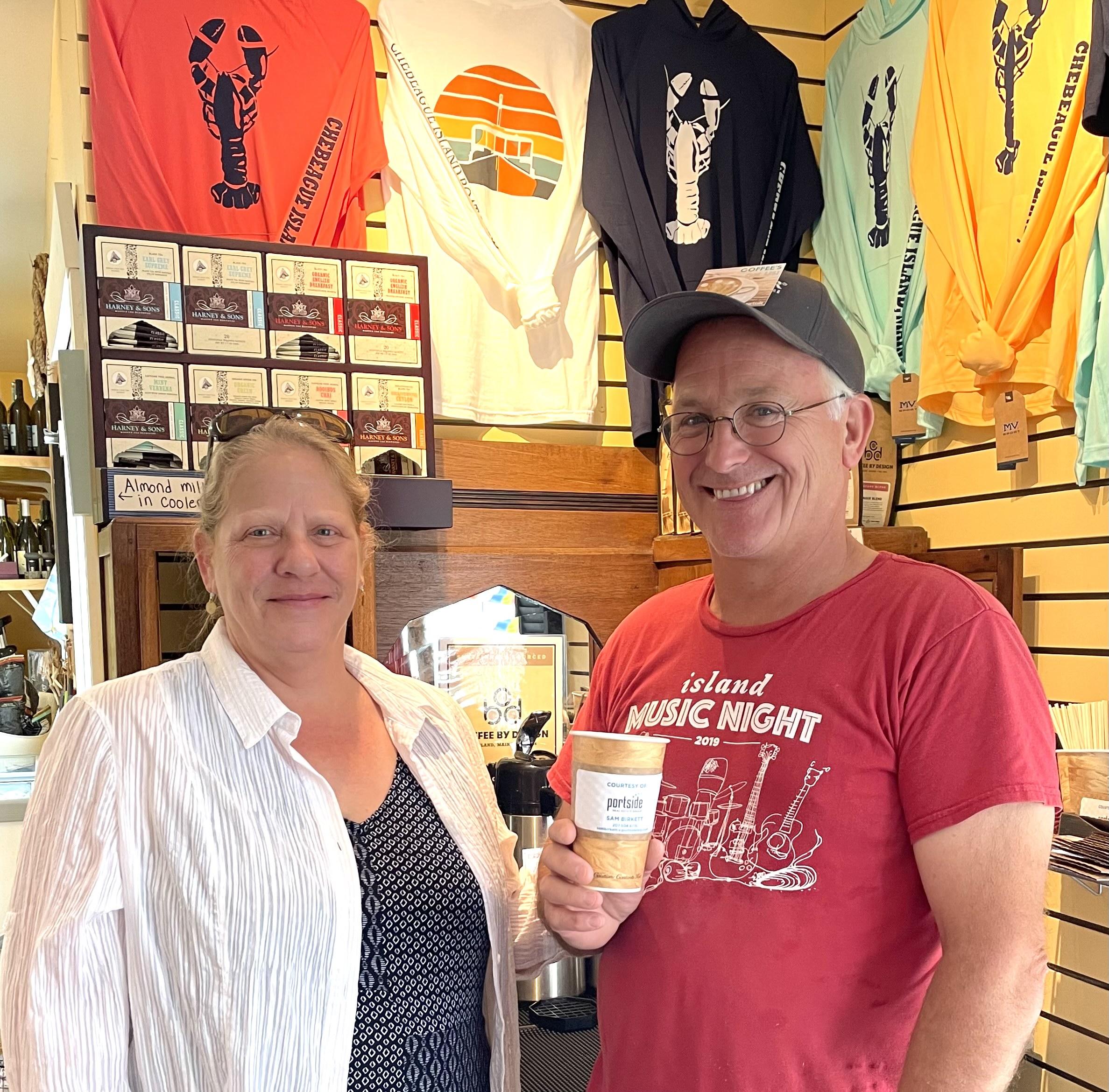 Two people standing enjoying cofee