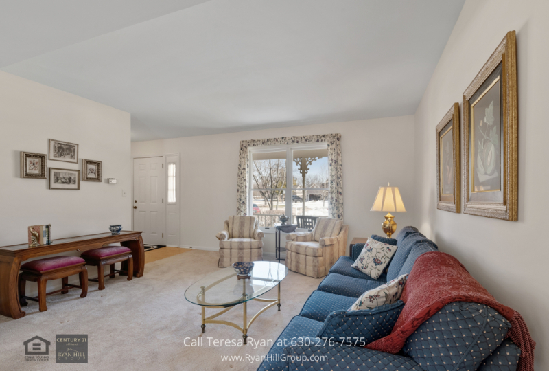 West Dundee IL home- Enjoy entertaining in the well-lit living area of this West Dundee IL home.