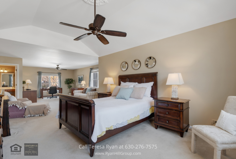 Home for sale in West Dundee IL- The spacious master bedroom of this home for sale in West Dundee IL offers ultimate privacy and relaxation.