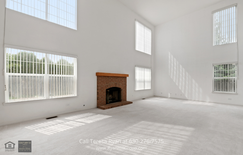 Streamwood, IL, home for sale - A relaxing family room with a brick gas fireplace for cold winter days and nights.