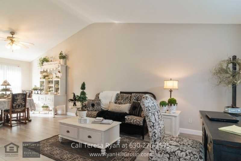 Oswego IL real estate- Experience the inviting and welcome feel of the spacious living room of this Oswego IL home for sale.