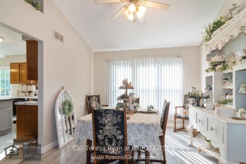 Real estate in Oswego IL- Enjoy sumptuous meals with your loved ones in the dining area of this home for sale in Oswego IL.