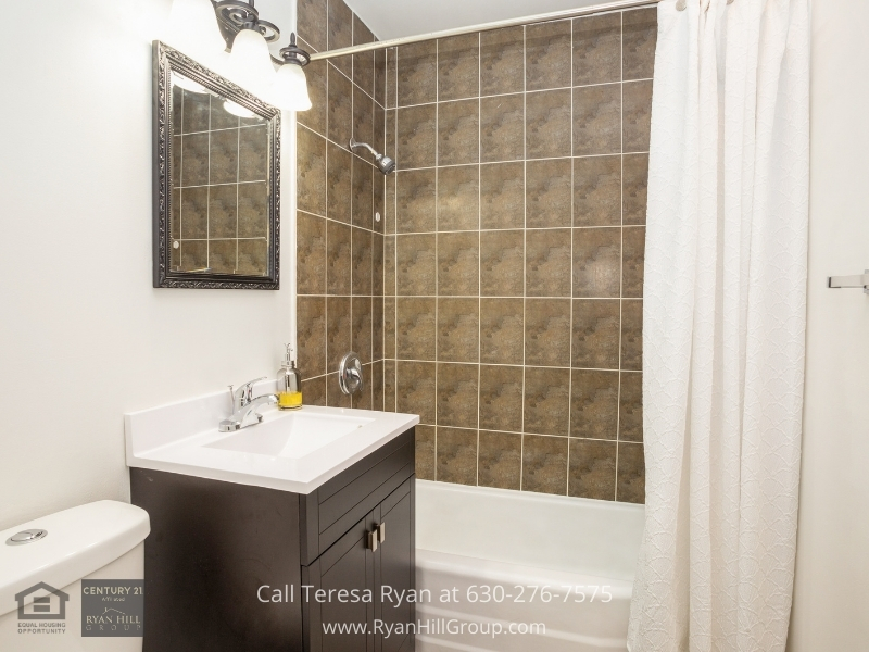 Hanover Park IL home for sale- Relax and unwind in the ensuite bathroom of this home for sale in Hanover Park IL.