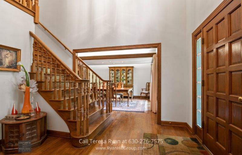 Winfield, IL home - Admire oak floors and oak beams as soon as you step into the main level of this Winfield, IL single-family home