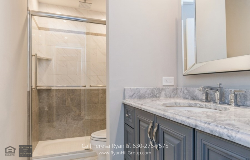 Real Estate in Aurora IL - This home has completely renovated kitchen, new baths, flooring and interior.