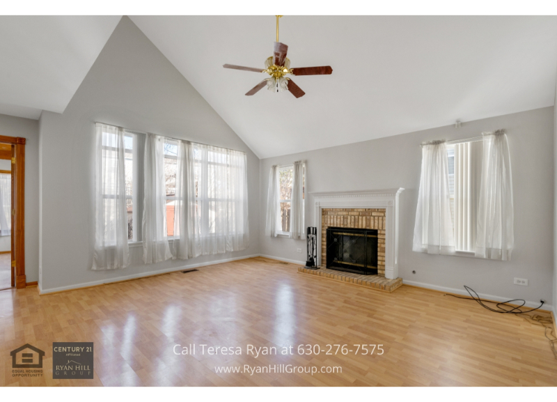 Carpentersville IL real estate- The cozy family room of this Carpentersville IL home is the perfect spot to go to relax and enjoy the company of family and friends.