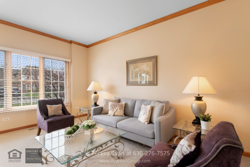 Real estate for sale in Naperville IL- The living room of this Naperville IL home is a great place to relax and unwind with your loved ones.