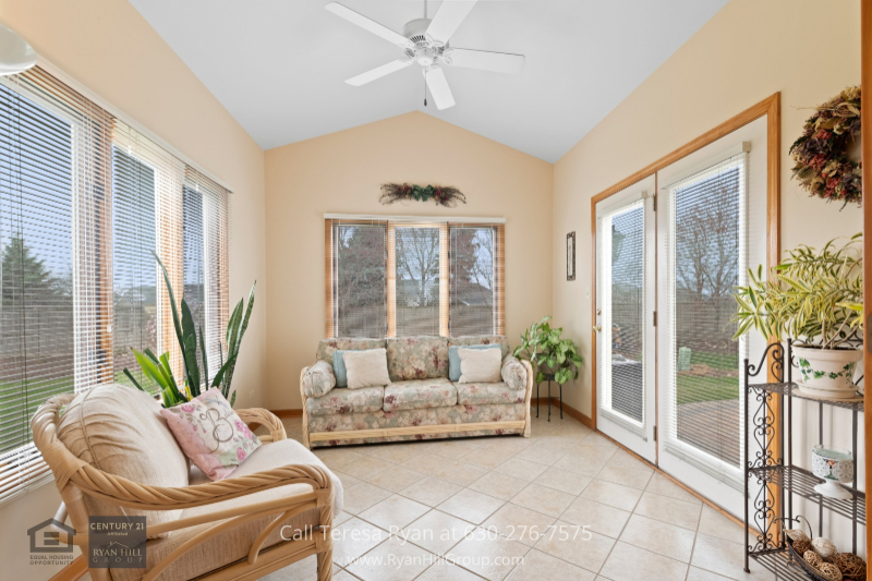 Naperville IL home for sale- Enjoy your morning espresso as you sit and capture the beautiful moment in the sunroom of this Naperville IL home.