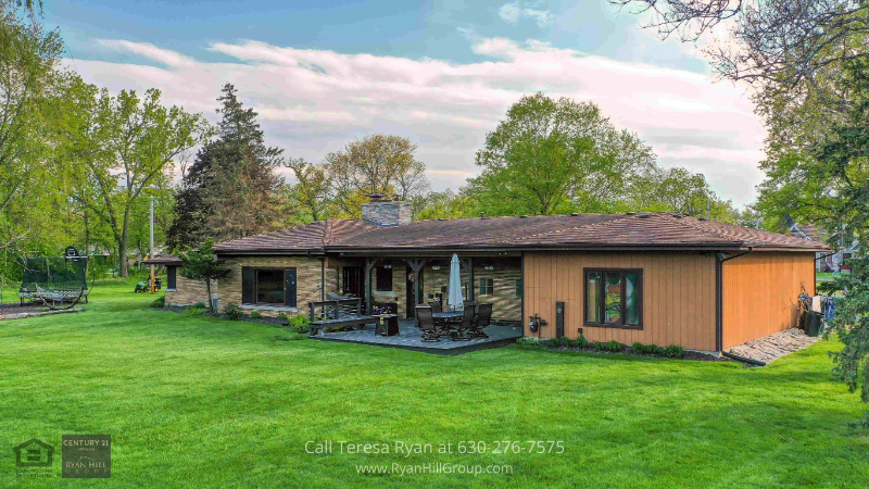 Real estate Bensenville, IL - Featuring a backyard patio with built-in seating this property in Bensenville, IL could be yours