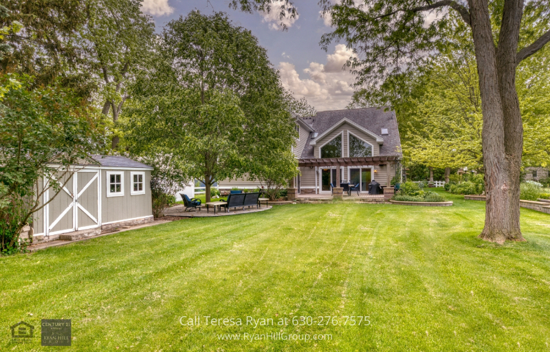 Property in Warrenville, IL - This home in Warrenville, IL has a stunning backyard view