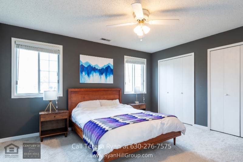 Real estate in Naperville IL- The cozy master bedroom of this Naperville IL home has everything you could wish for!
