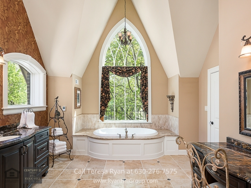 Luxury real estate in Naperville IL- Relax in the resort-like feel of the ensuite master bathroom of this Naperville IL luxury home.