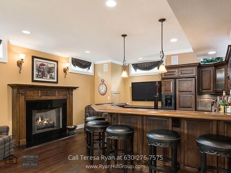 Naperville IL luxury real estate- Entertain freely in the expansive lower level bar and theater area of this Naperville IL luxury home.