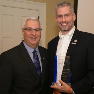 Robert Harrington presenting Joe Schutt with the Greater Boston Association of Realtors' Realtor of the Year 2016 award on June 14 at the associations annual awards and networking breakfast.