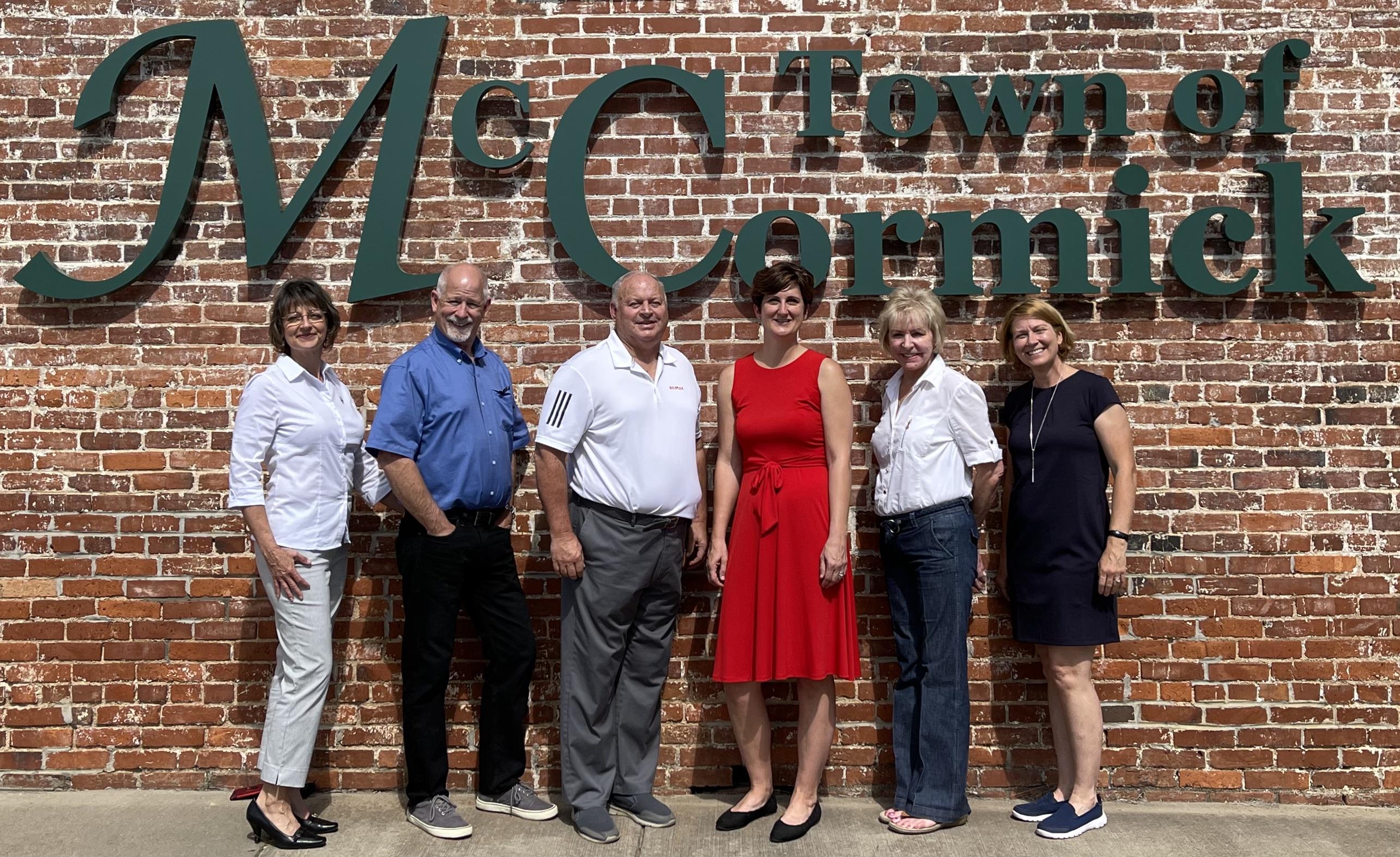 RE/MAX Leisurely Living Team: Karen Greene (Licensed Assistant), Tom Greene (REALTOR�), Russ Verrell (Owner, REALTOR�), Cara Verrell (Owner, Broker), Janet Martin (Office Manager), and Shannon Stewart (Marketing)