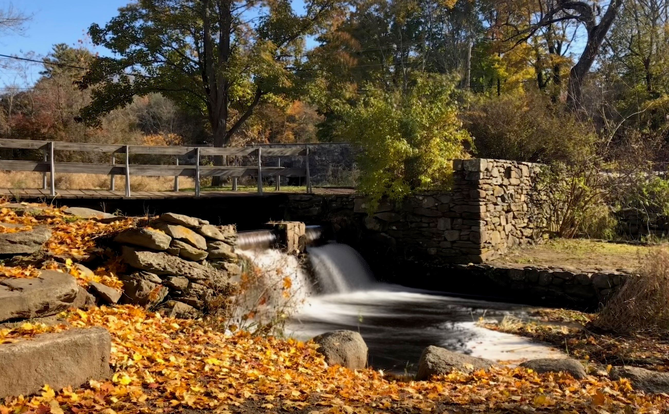 Bridge and small waterfall at Oliver Mill Park in Middleboro