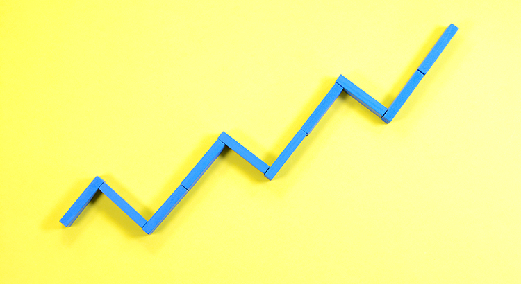blue line chart going up against yellow background
