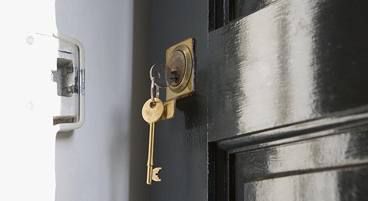 keys hanging from open door lock