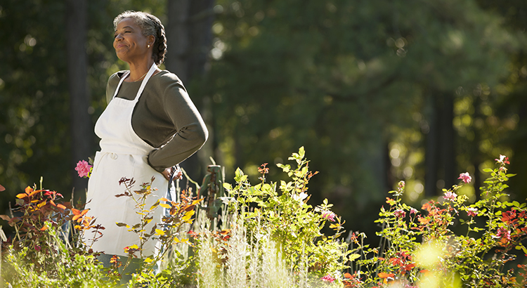 selling your home this spring with woman smiling outdoors