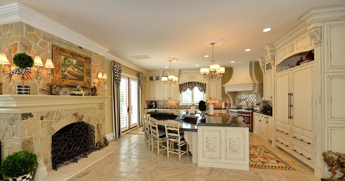 white kitchen of luxury market listed property with island