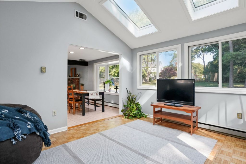 Light-filled living and dining area with skylights