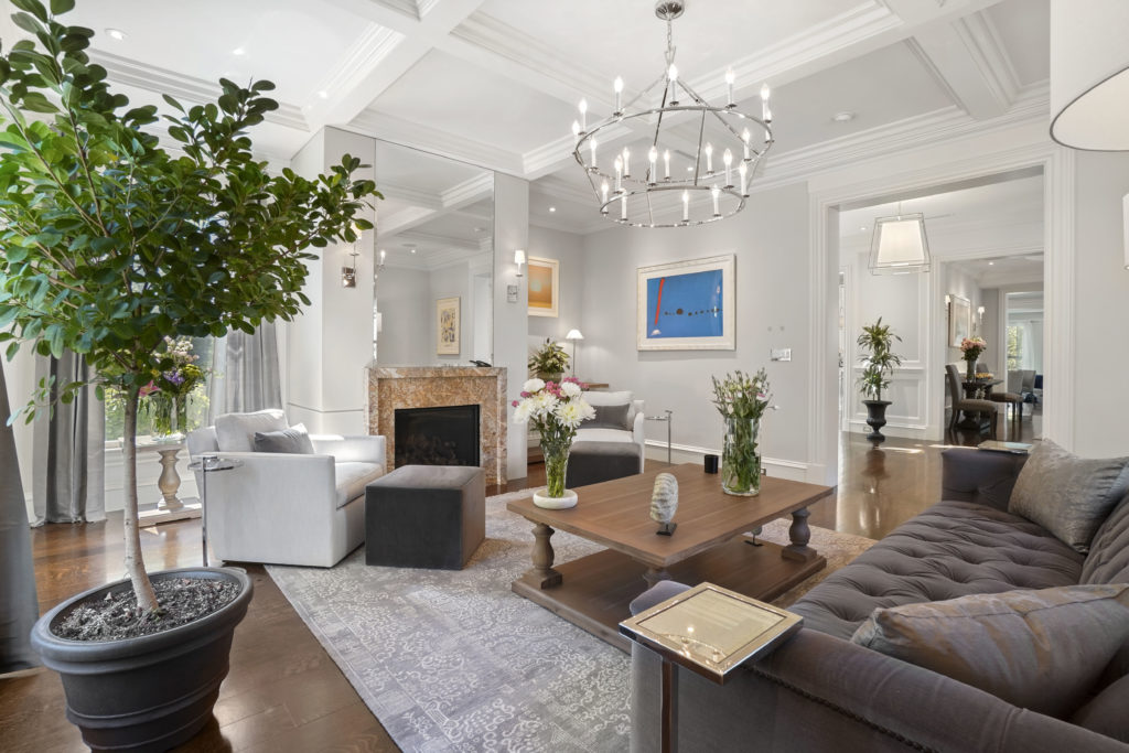 White living room with soaring vaulted ceilings