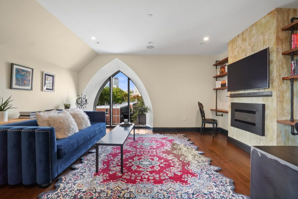 Living room with arched church window