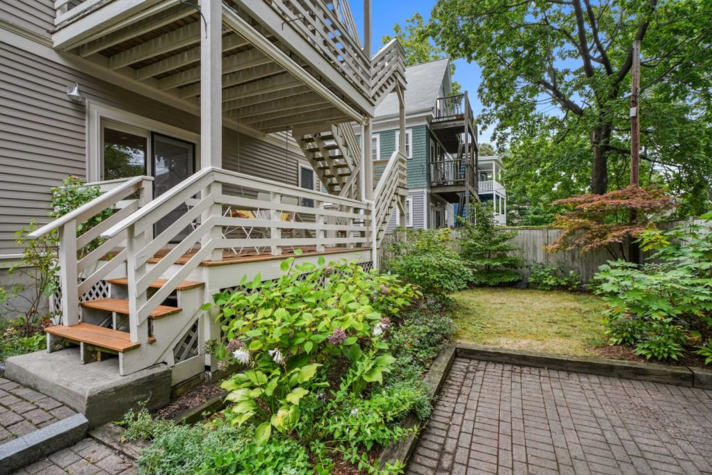 Back deck and patio with trees