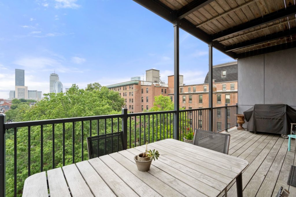 Deck with treetop and city views