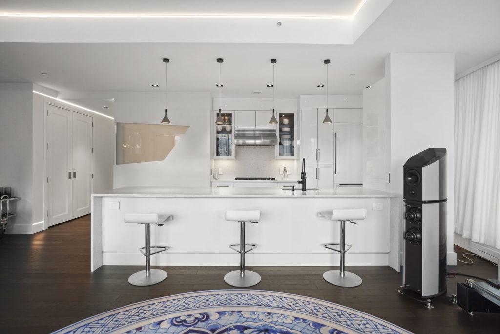 Sleek white kitchen and island