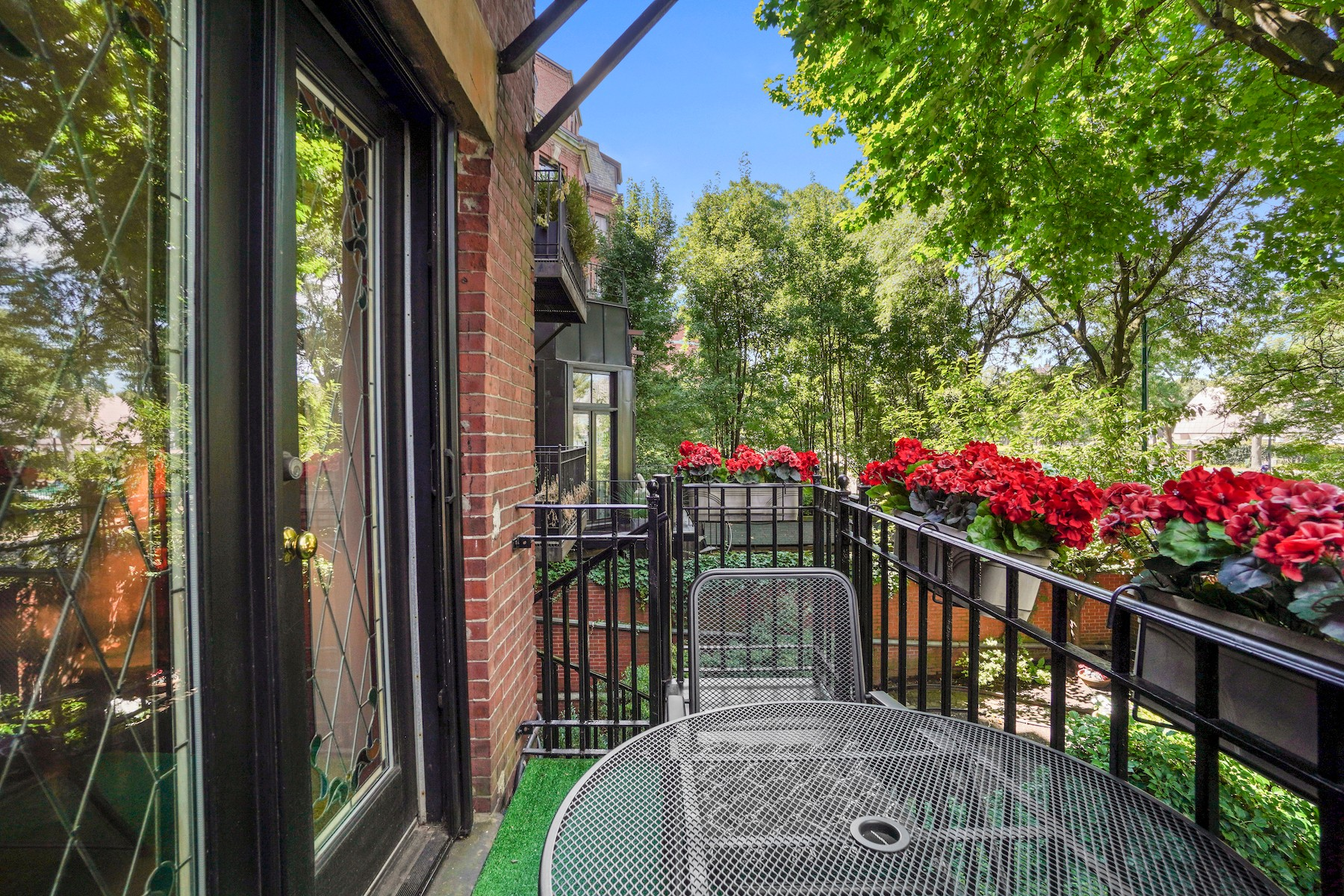Patio and fence with city views