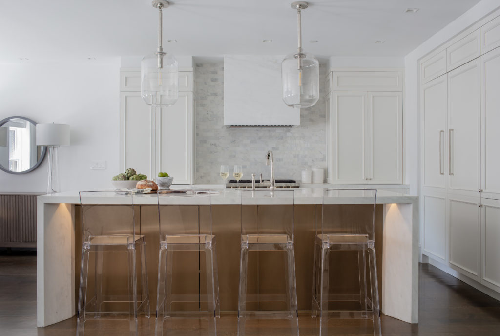 Sleek kitchen island with clear stools
