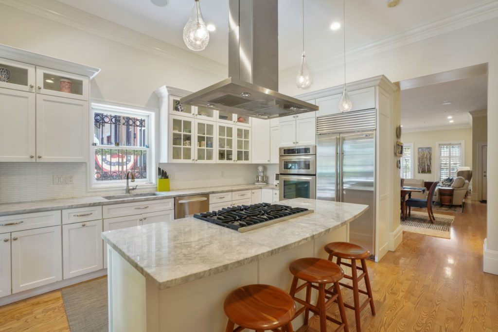 Kitchen island with hooded stove