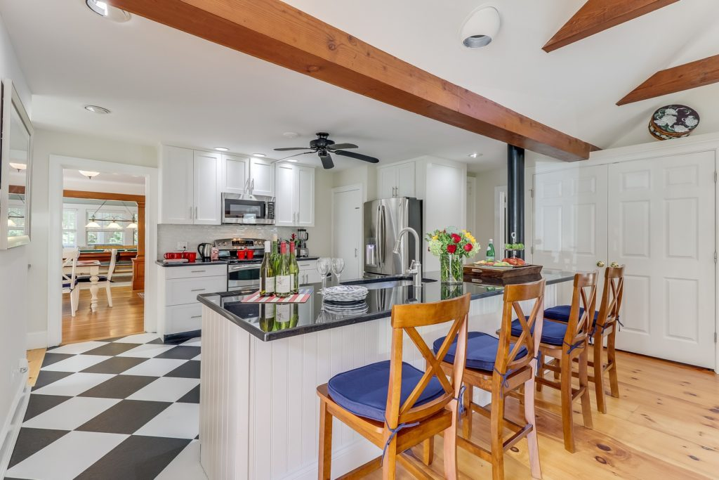 Kitchen island with beamed ceilings