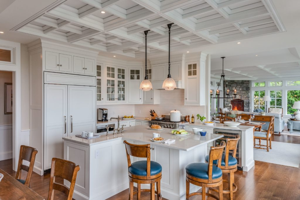 Kitchen with island and vaulted ceilings