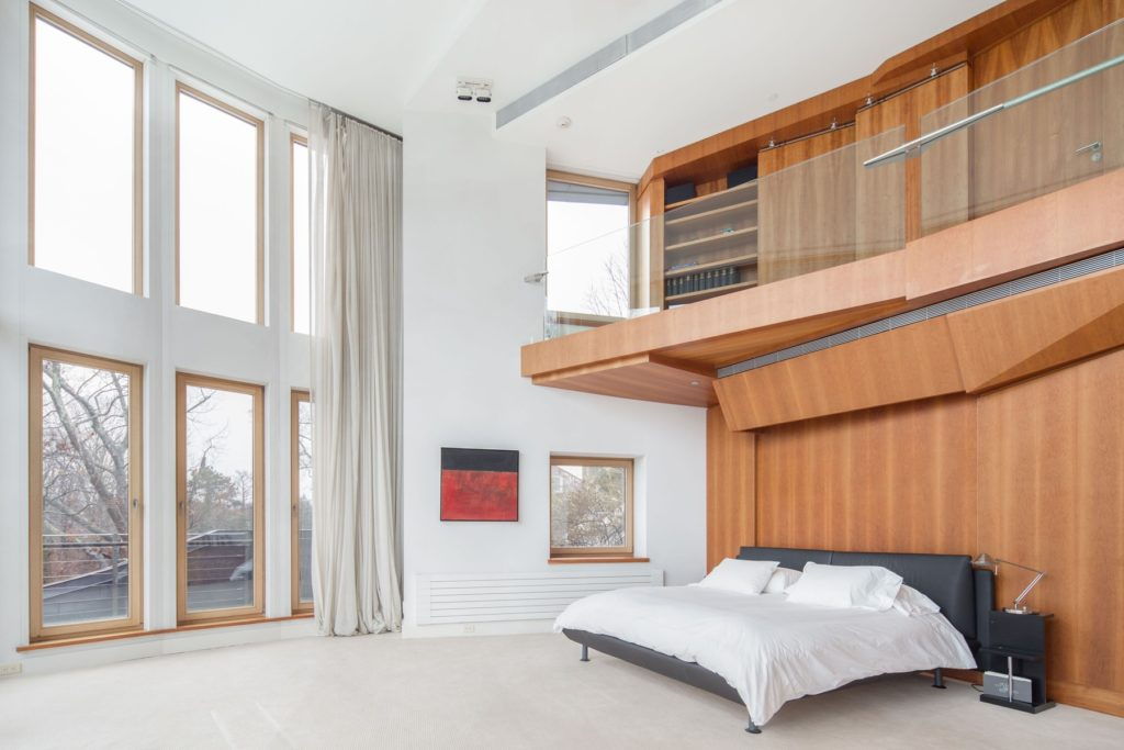 Beautiful bedroom with soaring ceilings and windows