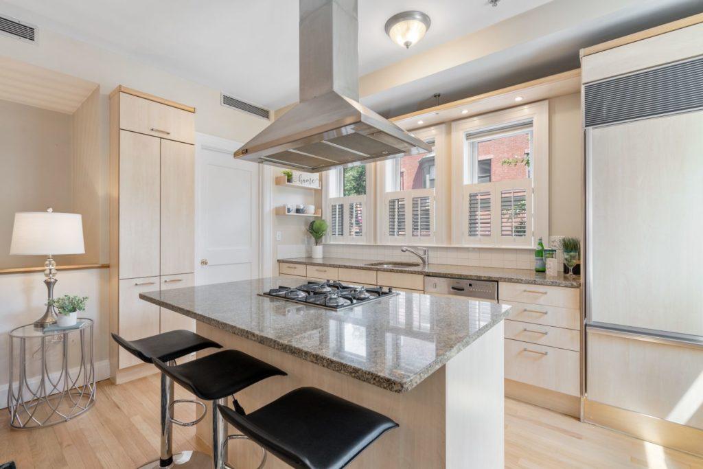 Sleek kitchen island with hooded stove
