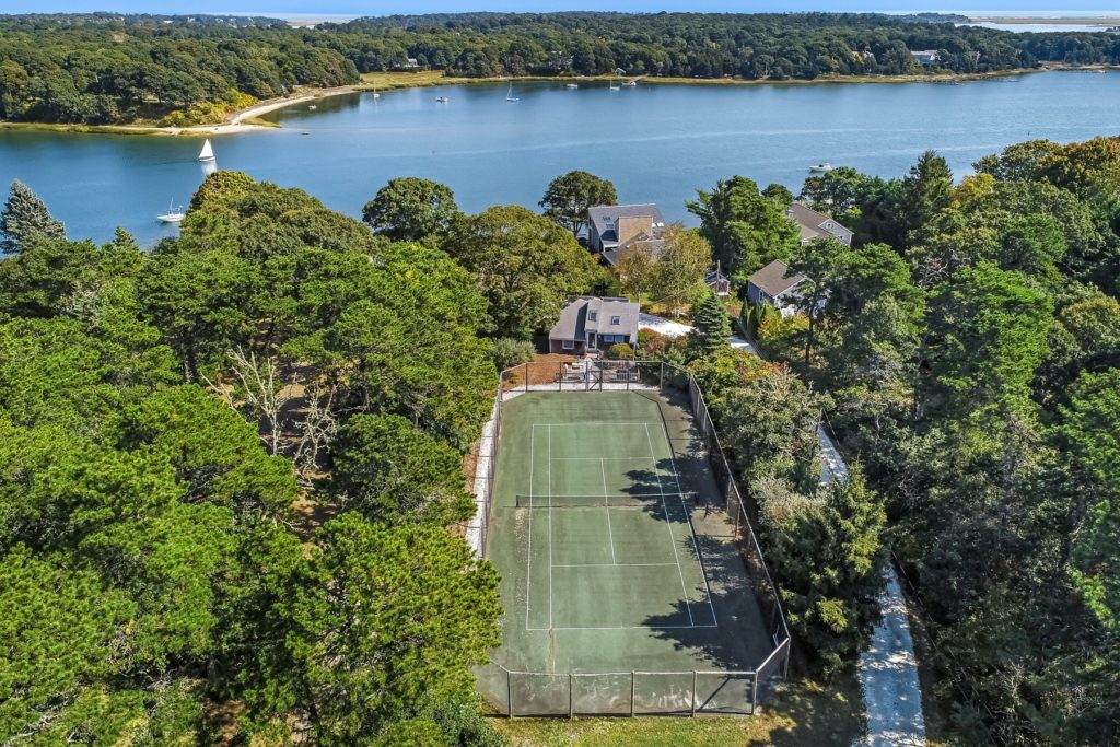 Waterfront home with tennis court