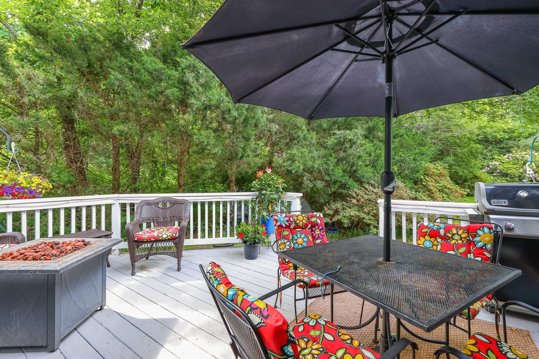 Back deck with table and umbrella