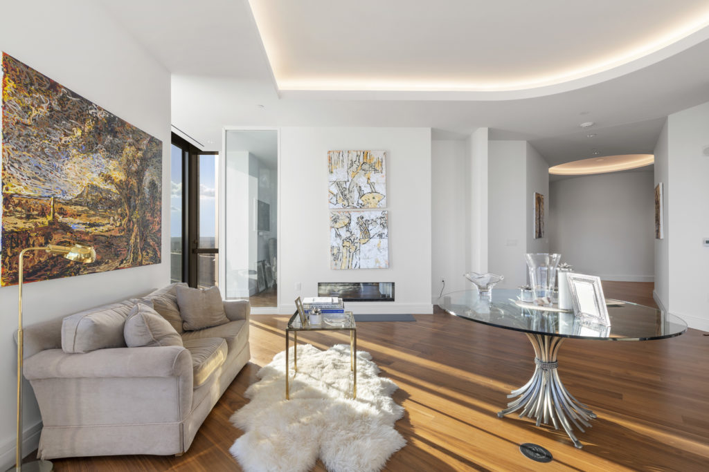 Open concept living room with wall art
