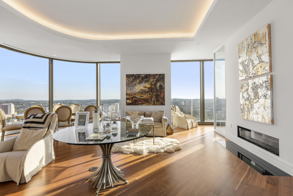 Open concept living room with wall art and city views