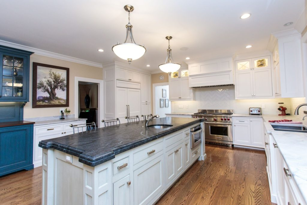 Black kitchen island with white cabinets
