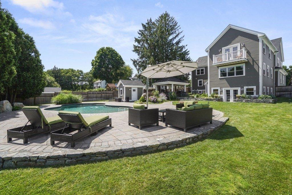 pool and backyard with seating